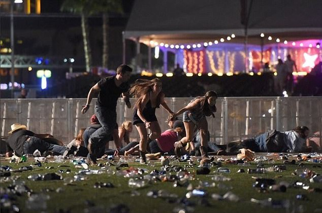 44F27C8700000578-0-People_flee_the_scene_of_the_shooting_in_Las_Vegas_Police_say_th-a-4_1506952690798.jpg
